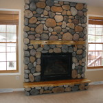 Adirondack Style Fireplace River Rock Cultured Stone And Wood