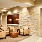 Amazing Commercial Interior Design Brick Wall Style Brown Arm Chair
