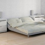 Comfortable Double Bed Colorful Pillows Bedside Table And Couch