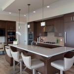 Kitchen Design Brown Cabinets And Shaped Bar