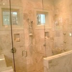 The Glass Enclosed Shower Encased Beautiful Sand Colored Honed