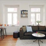 The Small Apartment Features Open Kitchen And Living Room