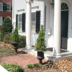 These Planted Urns Frame The Front Door Entrance Directing Viewer