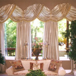 This Treatment Showcases Modern Austrian Shade Flanked Trimmed