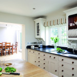 White Drawers And Black Counter Top Staged Properly Sell Home