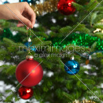 Woman Holding Christmas Ornament Hand Decorating Tree