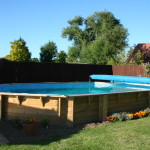 Wooden Pool That Has Been Landscaped Into The Garden Area