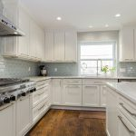 White Kitchen Cabinets Beige Backsplash